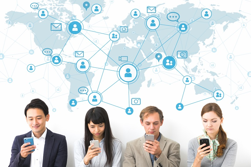 Social network concept. Group of people using smart phone.